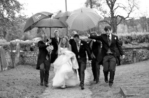 David and Olivia's Wedding in Suffolk - Groomsmen Save the Bride from Rain with their Umbrellas
