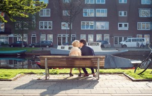 Newly Married couple Celebrate with a Kiss on the Keizersgracht Amsterdam Canal